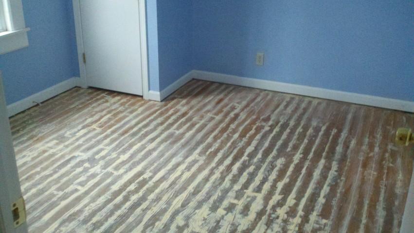 A damaged hardwood floor surface