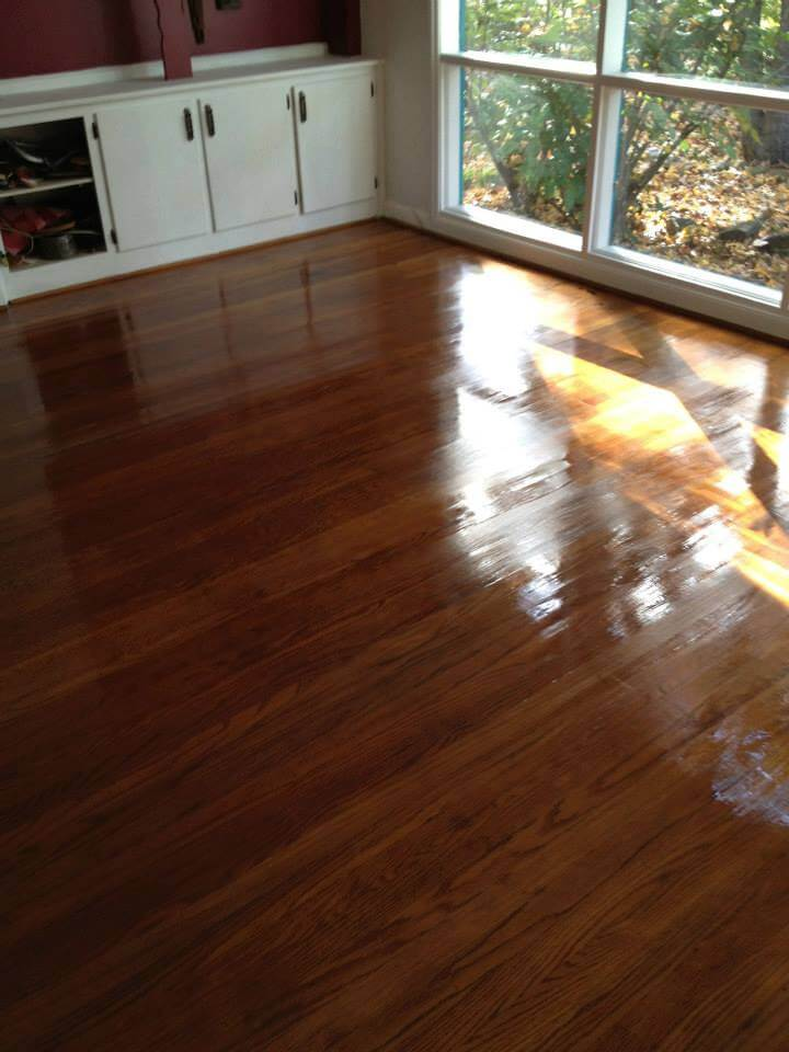 a well stained and practically glowing hardwood floor that was refinished by Fabulous Floors