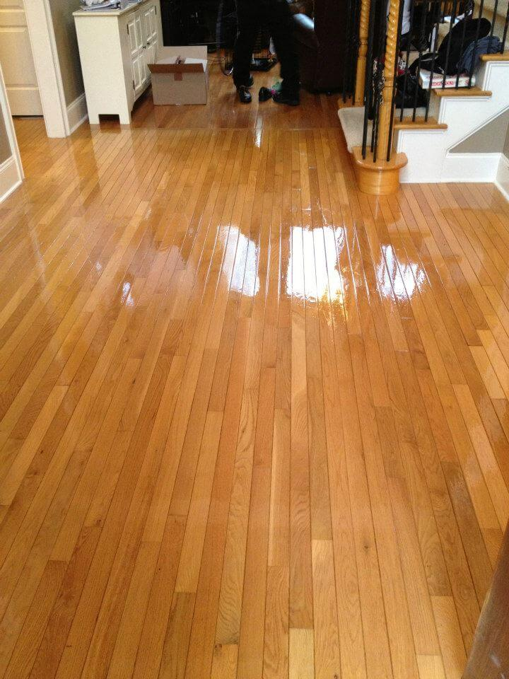 a shining resurfaced, light brown colored hardwood floor