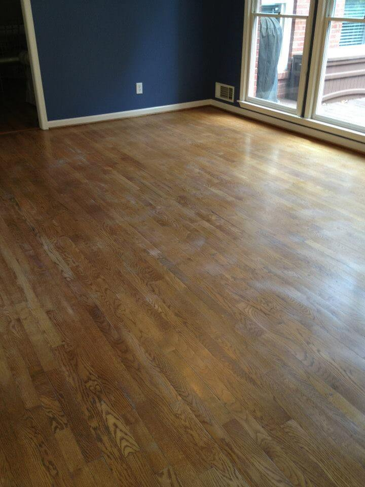 A lightly damaged and scuffed hardwood floor