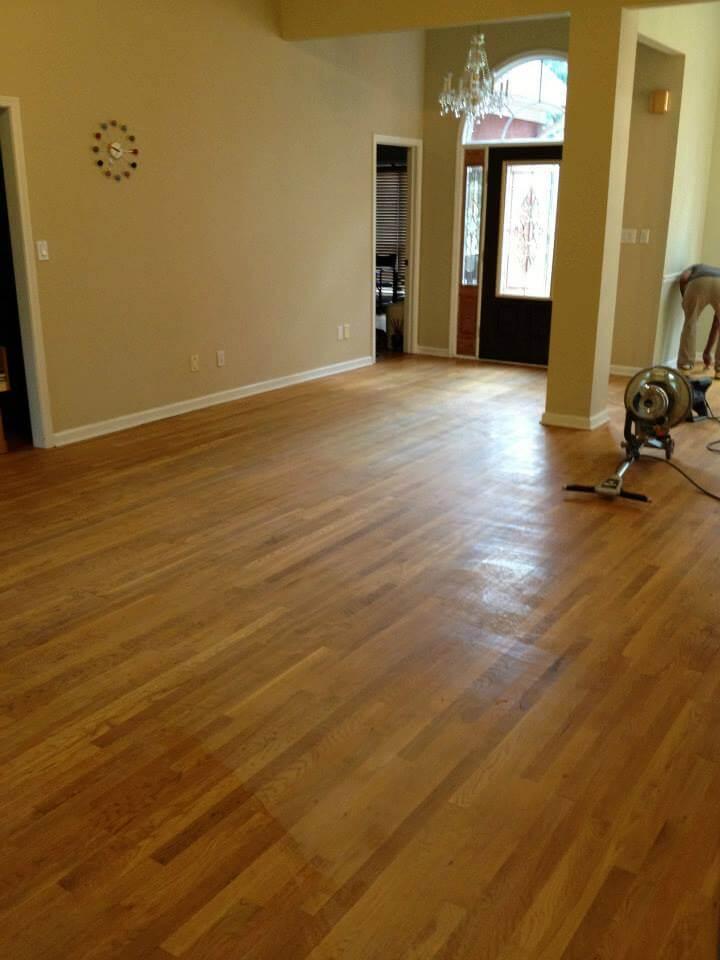 A hardwood floor in need of resurfacing